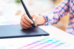 Graphic designer using her graphic tablet. In an office stock photos