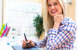 Graphic designer using her graphic tablet. In an office royalty free stock photo