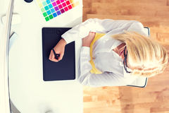 Graphic designer using her graphic tablet. In an office royalty free stock photography