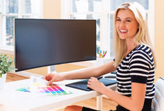 Graphic designer using her pen tablet device Royalty Free Stock Photo