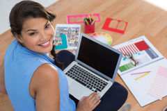Graphic designer using laptop in the office. Portrait of graphic designer using laptop in the office stock photos