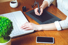 Graphic designer using tablet Royalty Free Stock Photography