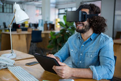 Graphic designer using the virtual reality headset and digital tablet. In creative office Royalty Free Stock Photography