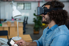 Graphic designer using the virtual reality headset and digital tablet. In creative office Stock Images