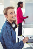 Graphic designer wearing headphones at desk. In casual office Royalty Free Stock Images