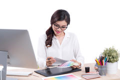 Graphic designer at work. Asian woman sitting on desk. Royalty Free Stock Images
