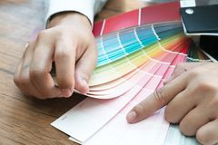 Graphic designer at work. Color samples. Photo picture.  royalty free stock image