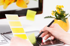 Graphic designer at work. Color samples. Royalty Free Stock Photography