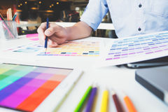 Graphic designer at work. Color swatch samples. Graphic designer working with color samples for selection. Graphic designer at work. Color swatch samples royalty free stock images