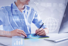 Graphic designer at work. Graphic designer drawing something on tablet at office Royalty Free Stock Image