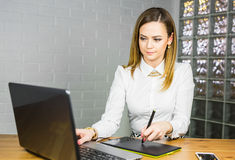 Graphic designer at work. Woman drawing with graphics tablet, working designer royalty free stock photos