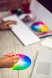Graphic designer working with colour chart. At workplace Stock Images