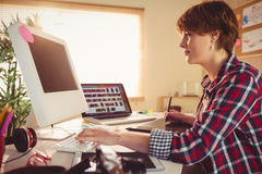 Graphic designer working at desk Royalty Free Stock Photography
