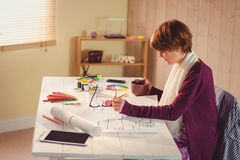 Graphic designer working at desk. In office royalty free stock photography
