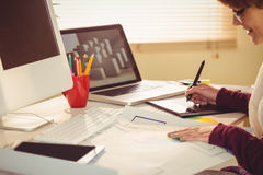 Graphic designer working at desk. In office Stock Images