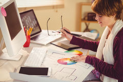 Graphic designer working at desk. In office royalty free stock photo