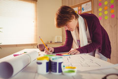 Graphic designer working at desk. In office royalty free stock image