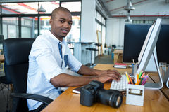 Graphic designer working at desk. Portrait of graphic designer working at desk in office stock images