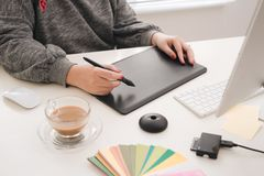 Graphic designer working with digital drawing tablet at office. Graphic designer working with digital drawing tablet at office stock photo