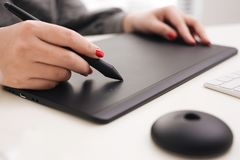 Graphic designer working with digital drawing tablet at office. Graphic designer working with digital drawing tablet at office royalty free stock photo