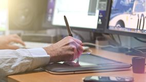 Graphic Designer working with digital Drawing tablet and Pen stock footage