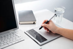 Graphic designer working on digital tablet. And computer royalty free stock photography