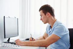 Graphic designer working on digital tablet. And computer royalty free stock image