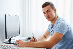 Graphic designer working on digital tablet Stock Photo
