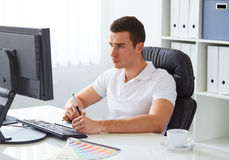 Graphic designer working on digital tablet. In office royalty free stock photos