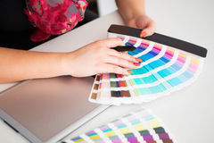Graphic designer working on a digital tablet and with pantone Stock Photos