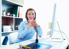 Graphic designer working at the home office - modern business co. Media worker working at the home office - modern business concept stock images