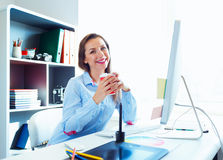 Graphic designer working at the home office - modern business co. Media worker working at the home office - modern business concept stock photography