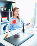 Graphic designer working at the home office - modern business co. Media worker working at the home office - modern business concept royalty free stock photo