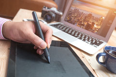 Graphic Designer working with interactive pen display, digital D stock images