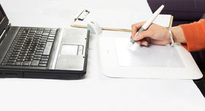 Hands on graphic tablet Stock Image