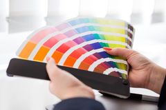 Graphic designer working with pantone palette Royalty Free Stock Images