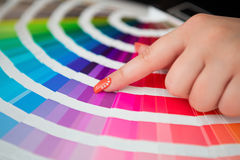 Graphic designer working with pantone palette. In studio stock photos