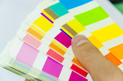 Graphic designer working with pantone palette. In studio stock images