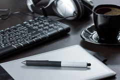 Graphic designer workplace. Graphic tablet, keyboard and coffee royalty free stock photography