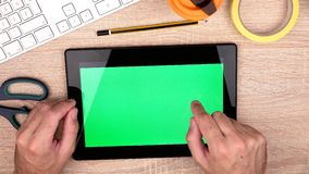 Graphic designer workspace from above, hands using digital tablet computer stock video footage