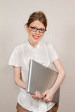 Graphic designer. Young beautiful professional graphic designer with large laptop in her hands Royalty Free Stock Photography