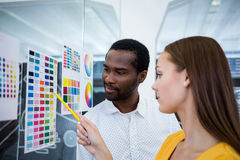 Graphic designers looking at color chart. In office Royalty Free Stock Image