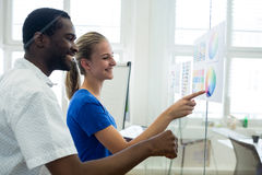 Graphic designers looking at color chart. In office Stock Photo