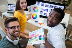 Graphic designers at their desk Stock Images