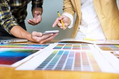 Graphic designers use the smart phone to choose colors from the royalty free stock photos