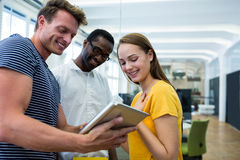 Graphic designers using digital tablet. In office Royalty Free Stock Image