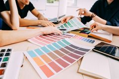 Graphic designers working with color samples stock photo