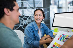 Graphic designers working at desk Royalty Free Stock Image