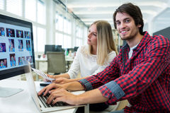 Graphic designers working at their desk Stock Photo