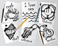 Graphic drawings of marine animals made with black mascara on white paper. Pencil, brush and pen on the table. Drawing and creativ Royalty Free Stock Image